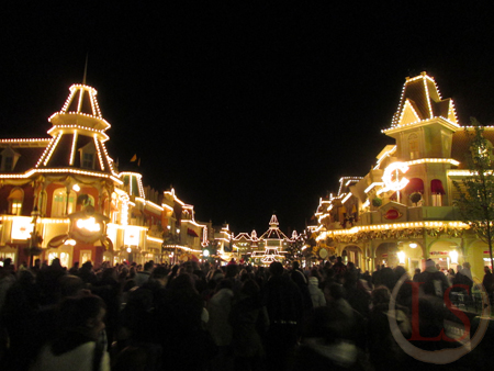 disneyland paris at night, main street lit for the 20th anniversary