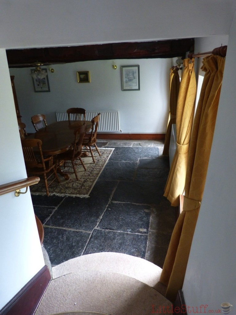 Looking down the steps from the hall into the dining room