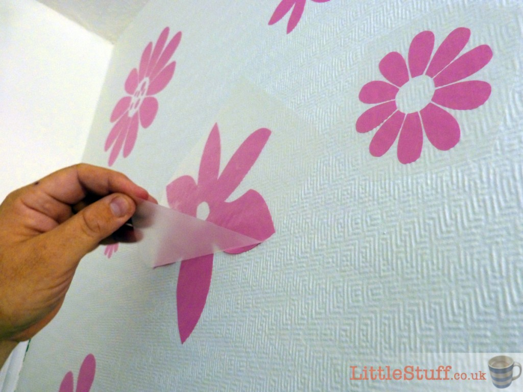 applying-wall-stickers-textured-wallpaper