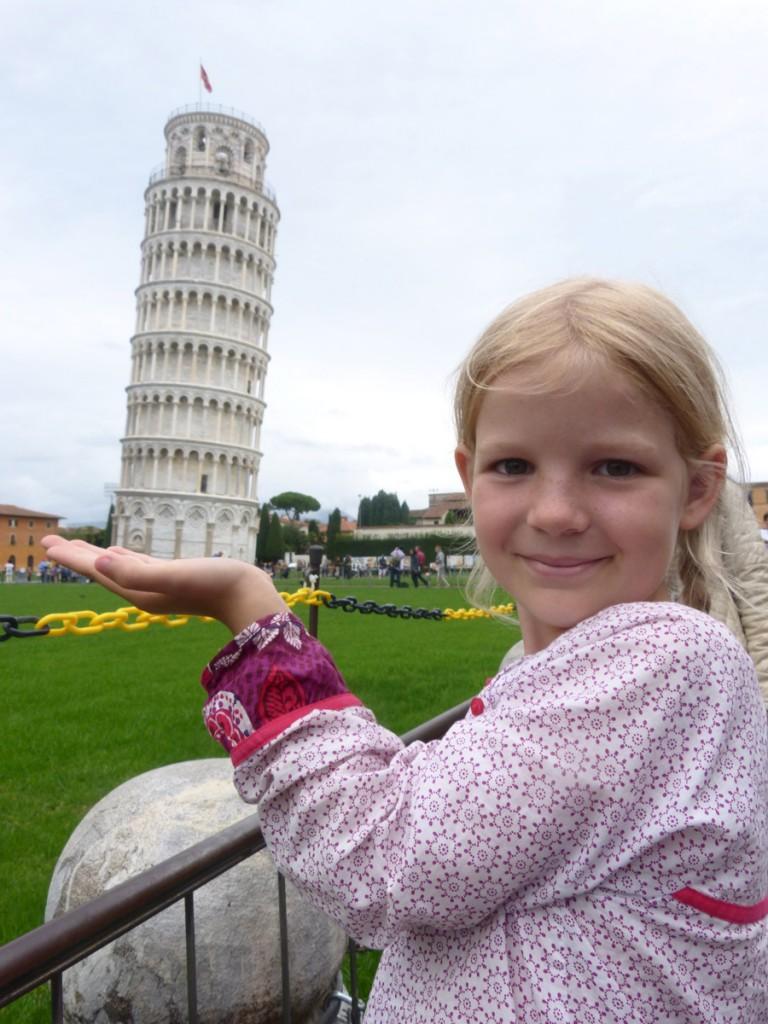 girl-plaits-holds-tower-pisa