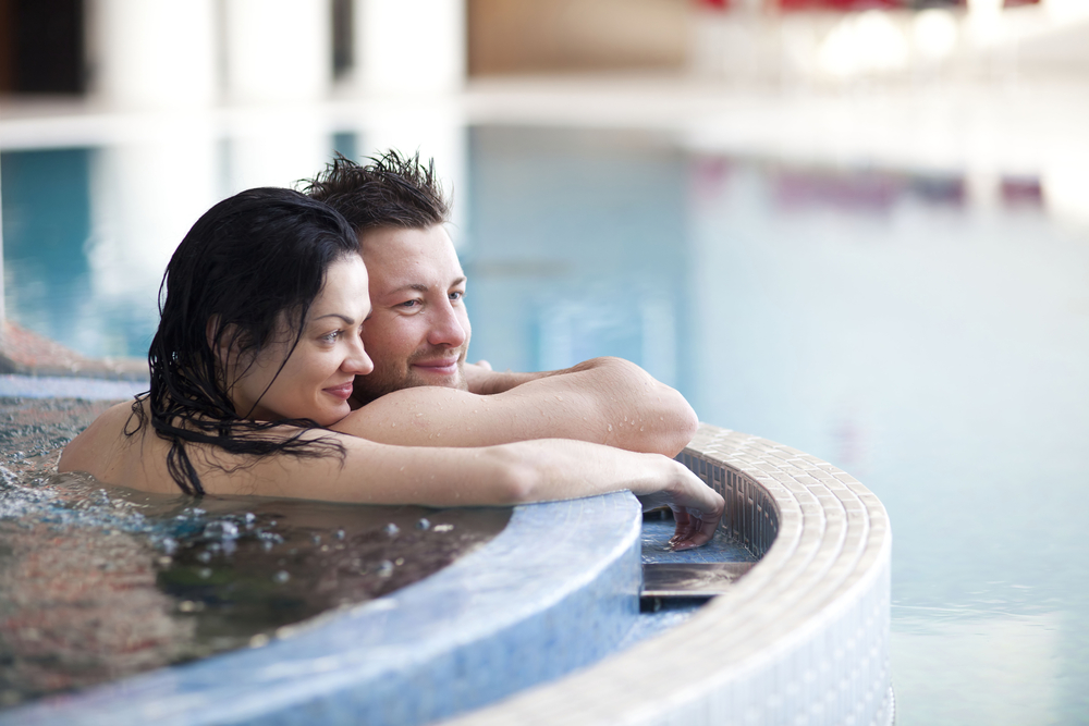 Couple enjoying a spa day together - image courtesy of Shutterstock