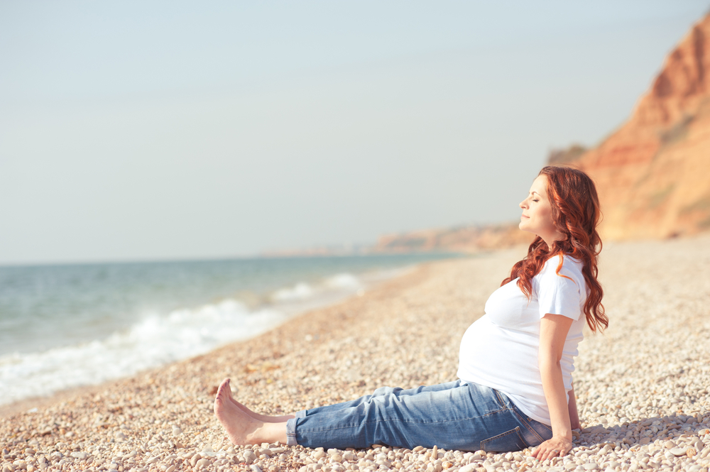 Pregnant lady on the beach - image courtesy of Shutterstock
