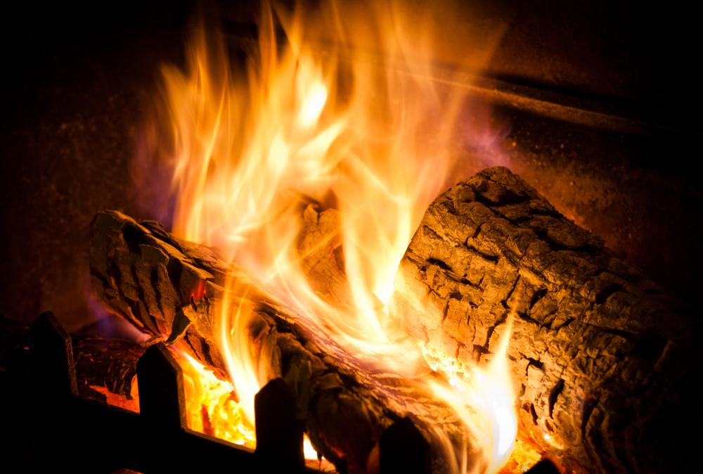 image of logs burning courtesy of shutterstock