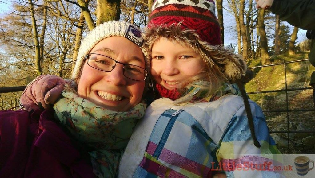 mum and daughter smiling in winter hats