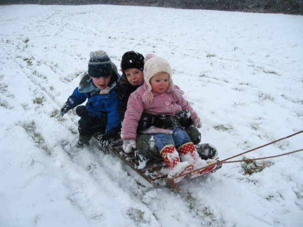 family sledging in dorset snow
