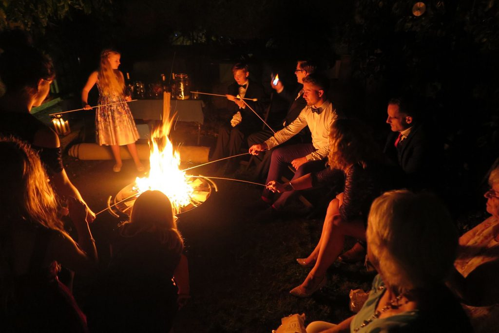 fire pit in a garden toasting marshmallows