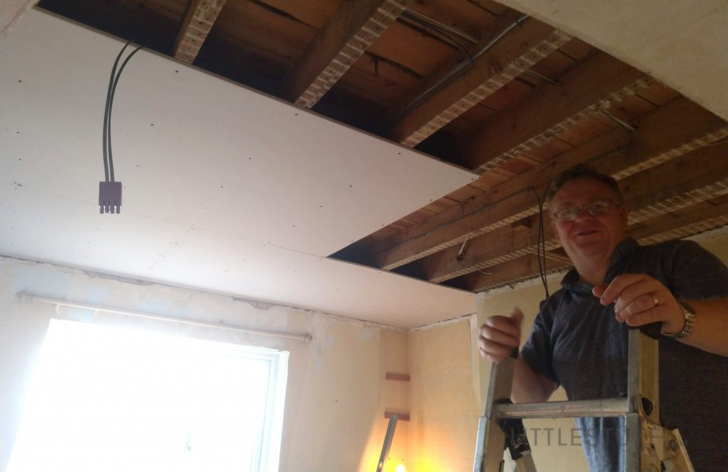 new plasterboard ceiling being fitted